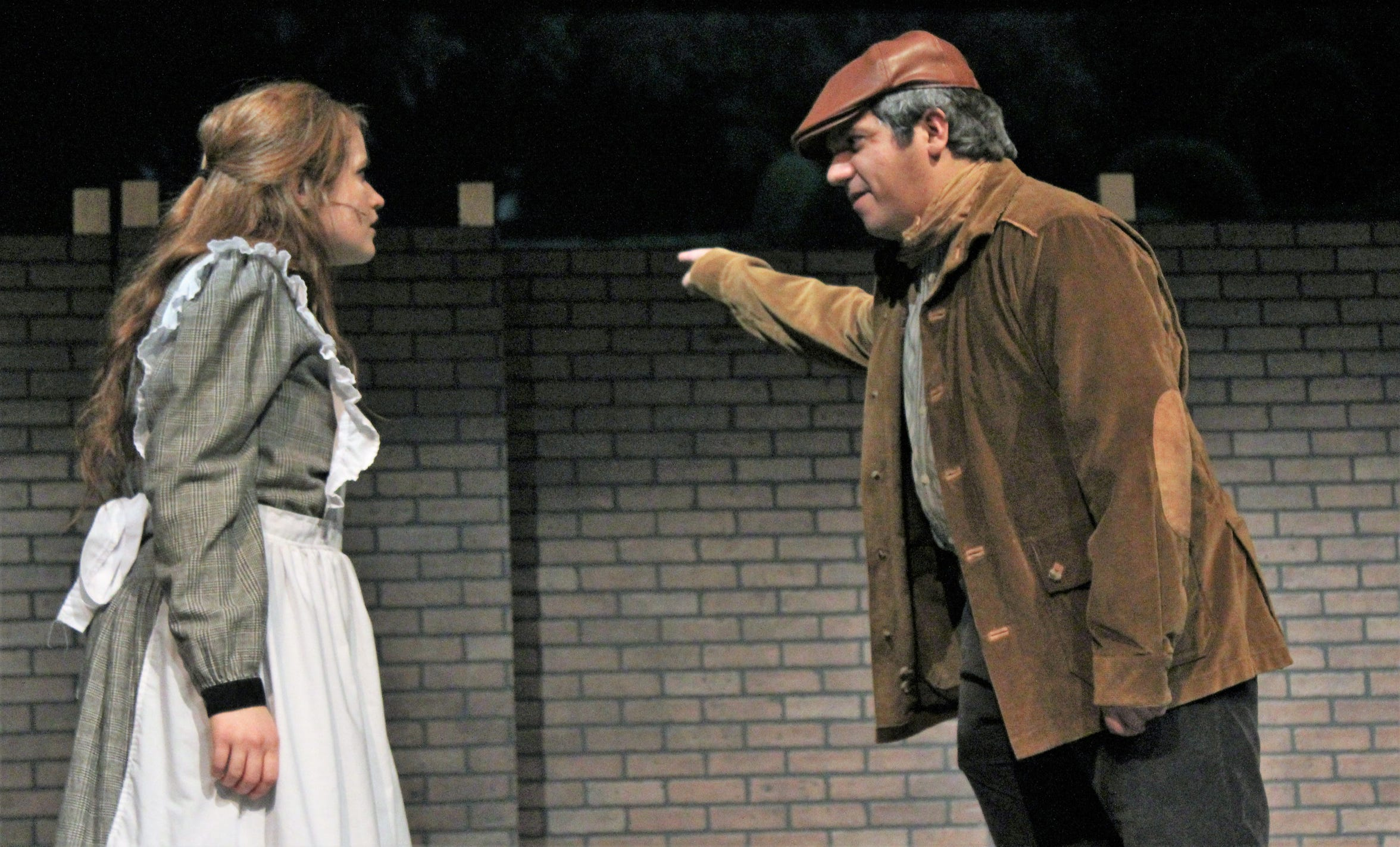 """The gardener Ben (Tony Barone) advises Mary (Maddie Lowry) that the garden is off limits in this rehearsal scene from """"The Secret Garden."""""""