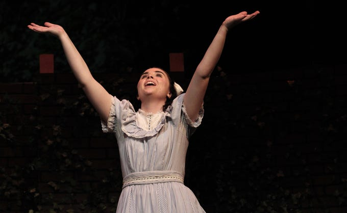 """Mary (Shelby Walker) raises her arms in joy in this rehearsal scene from """"The Secret Garden,"""" Hardin-Simmons University's musical that begins Wednesday and continues through a Sunday matinee. Walker, a Cooper High grad, shares the lead role with Maddie Lowry, a Wylie High grad. Feb. 3 2020"""
