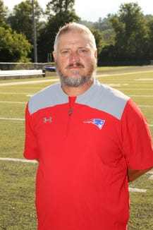 Madison head football coach Jamie Extine