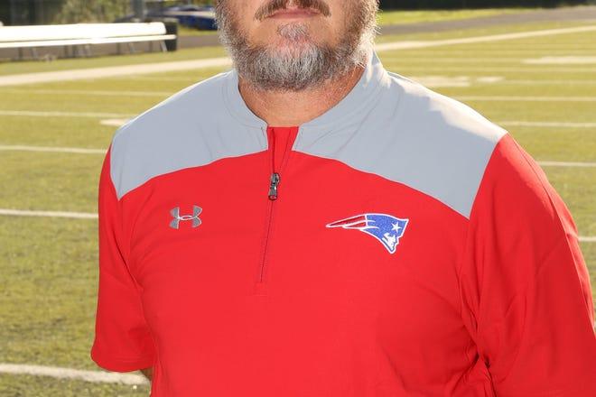 Madison head football coach Jamie Extine