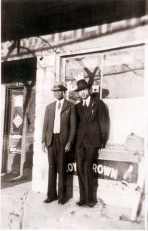 Edward W. Pearson Sr., standing in front of his store with Clifford W. Cotton Sr. The store was located at 3 Buffalo St. in West Asheville. His son, E. W. Pearson Jr., ran a music club (Blue Note Casino) at that address after his father died.