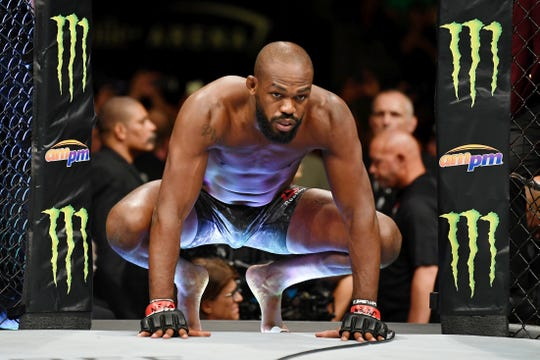 Jul 6, 2019; Las Vegas, NV, USA; Jon Jones (red gloves) before his fight against Thiago Santos (not pictured) at T-Mobile Arena. Mandatory Credit: Stephen R. Sylvanie-USA TODAY Sports