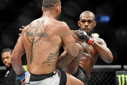 Jul 6, 2019; Las Vegas, NV, USA; Jon Jones (red gloves) fights against Thiago Santos (blue gloves) at T-Mobile Arena. Mandatory Credit: Stephen R. Sylvanie-USA TODAY Sports