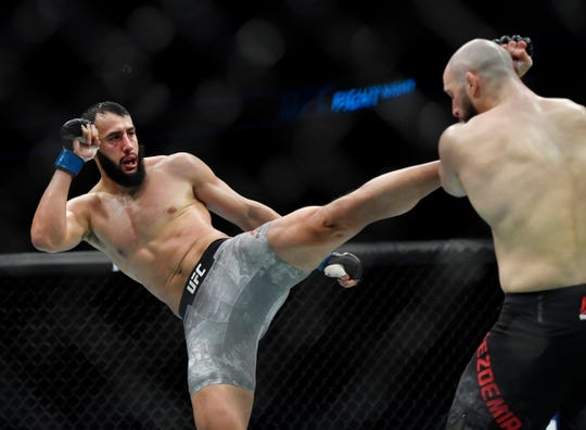 Mar 16, 2019; London, UK; Dominick Reyes (blue gloves) and Volkan Oezdemir (red gloves) during UFC Fight Night at O2 Arena. Mandatory Credit: Steve Flynn-USA TODAY Sports