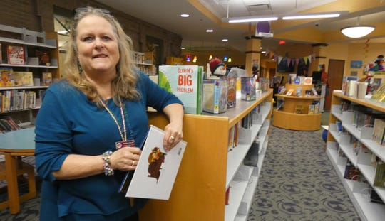 """""""I have such a passion for what I do,"""" said Barb Scott, children's librarian. """"I love coming to work."""""""