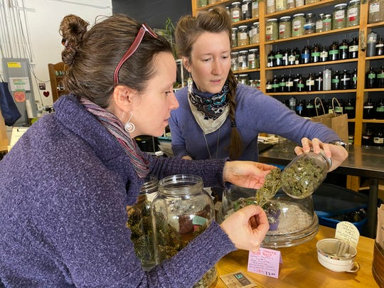 """Jessilyn Dolan, left, of the Vermont Cannabis Nurses Association brings in her certified """"clean, green"""" hemp product to be sold at Railyard Apothecary in Burlington in February 2020."""