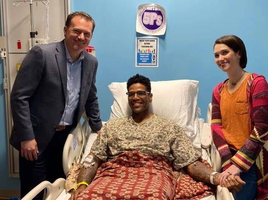 CCPD shared a photo of U.S. Congressman Michael Cloudvisiting Officer Love and his family at the hospital.