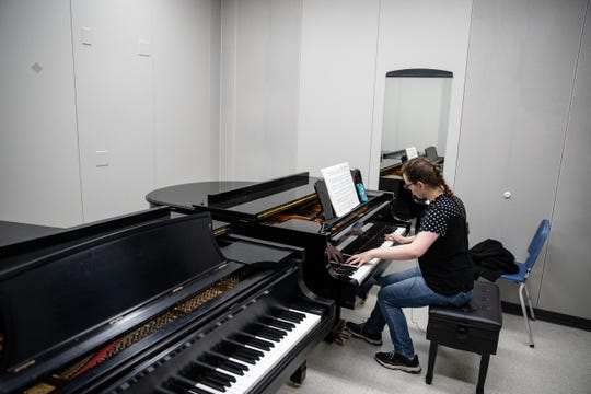 Del Mar College student Marry Flint plays the piano inside practice room in the schools new Music Building on Tuesday, Feb. 2020.