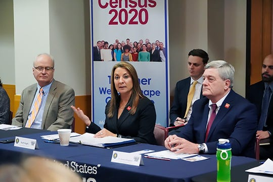 Texas Secretary of State Ruth Hughs, center,  leads a roundtable discussion on the 2020 census with State Demographer Lloyd Potter, left, and  U.S. Census Bureau Director Steven Dillingham at the Texas Capitol in December 2019.