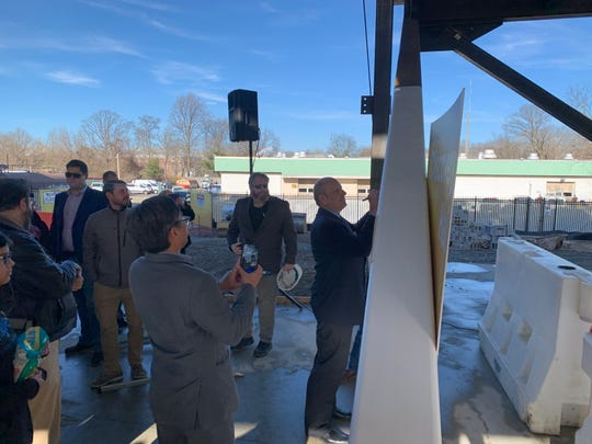Ken Lacovara - a reknown paleontologist and geologist - signs a beam of Discovery Hall on Rowan University's Glassboro campus Feb. 3, 2020. The academic building on Mullica Hill Road will be the headquarters for the college's School of Earth and Environment, of which Lacovara is the dean.