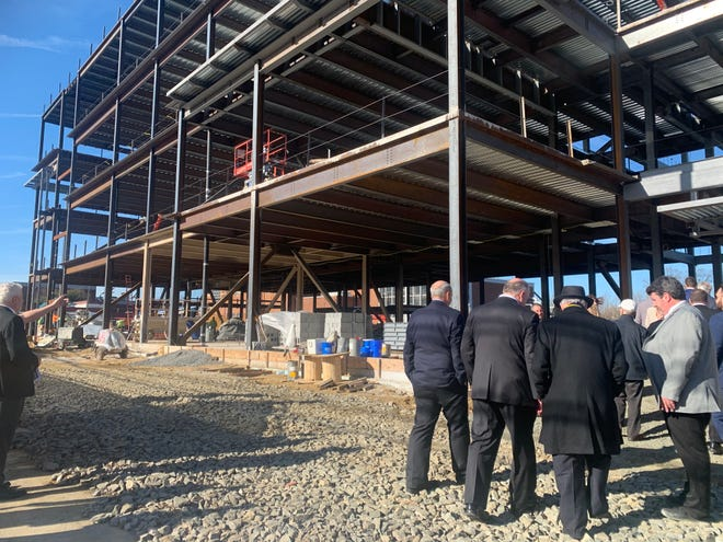 Senate Pres. Steve Sweeney (center) walks the grounds of the Rowan University's newest Glassboro campus building - Discovery Hall - Monday, Feb, 3, 2020.