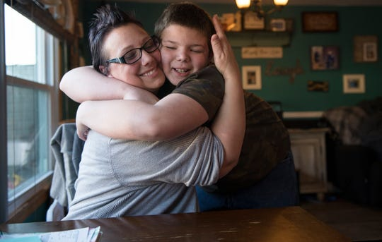 Jaime Trabbold hugs her 10-year-old autistic son, Ronnie, in their Maple Shade home.  Trabbold wants state lawmakers to consider legislation she's pushing that would require hospitals to make accommodations for people with mental illnesses and developmental disabilities like autism.