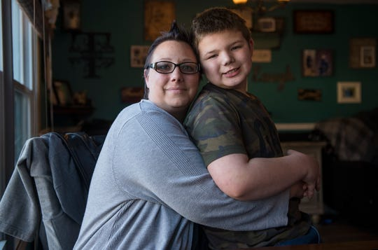 Jaime Trabbold sits with her 10-year-old autistic son, Ronnie, in their Maple Shade home.  Trabbold wants state lawmakers to consider legislation she's pushing that would require hospitals to make accommodations for people with mental illnesses and developmental disabilities like autism.
