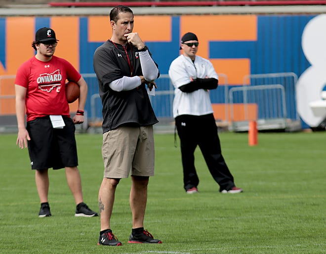 UC head football coach Luke Fickell watches his team during practice at Nippert Stadium on April 6, 2019.