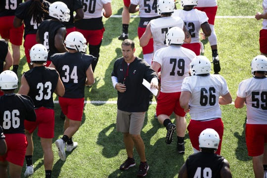 Cincinnati Bearcats head coach Luke Fickell talks to players during practice at Higher Ground Convention Center in West Harrison, Ind. on Aug. 3, 2018.