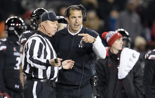 Cincinnati Bearcats head coach Luke Fickell talks to a referee during the game against the South Florida Bulls on Nov. 10, 2018, at Nippert Stadium.
