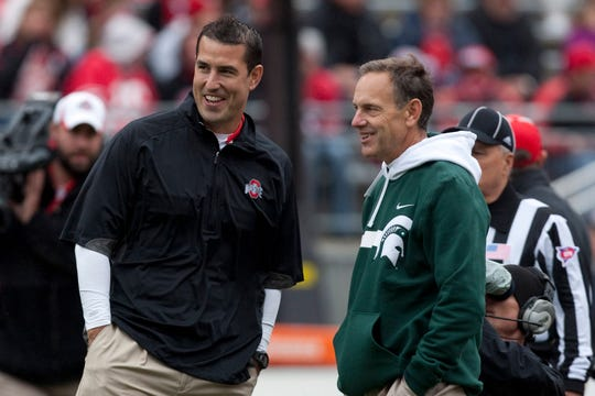 Ohio State Buckeyes head coach Luke Fickell and Michigan State Spartans head coach Mark Dantonio share a laugh before their game at Ohio Stadium on October 1, 2011.