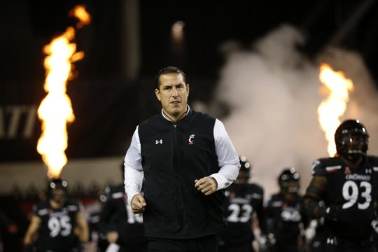 Cincinnati Bearcats head coach Luke Fickell leads his team onto the field for the first quarter against the Temple Owls at Nippert Stadium on Nov. 23, 2019.