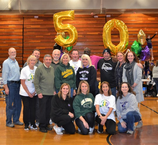Alumni athletes, who were recognized on Jan. 29, at Carl Sandburg Middle School's 50th anniversary sports alumni event.