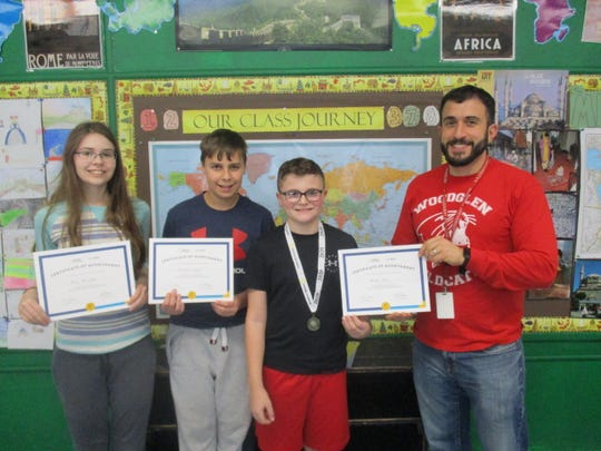 Sixth grade Geography Bee Champs at Woodglen School. (Left to right): Elena McLaughlin, Alex Atchley, Michael Wellet and  James Savakis