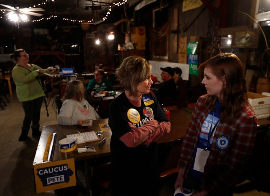 Honor Monaghan, left, and Kala Duysen talk before the caucus got underway at The Hayloft in Grant, Iowa on Feb. 3, 2020.