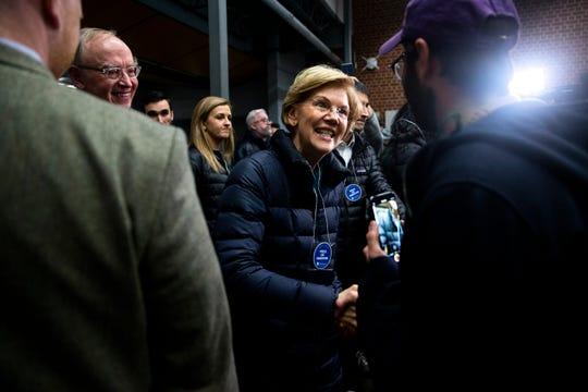 U.S. Sen. Elizabeth Warren, D-Mass., greets caucus goers at Roosevelt High School on Monday, Feb. 3, 2020, in Des Moines.
