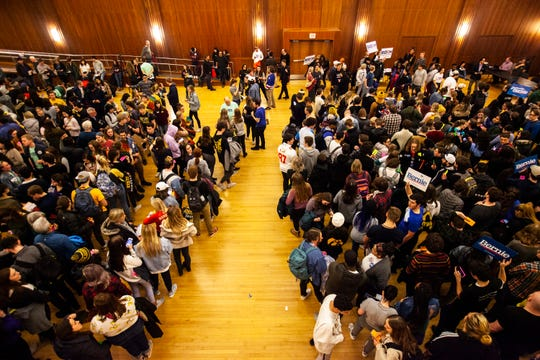 University of Iowa students divide into preference groups while they caucus, Monday, Feb. 3, 2020, at the Iowa Memorial Union in Iowa City, Iowa.
