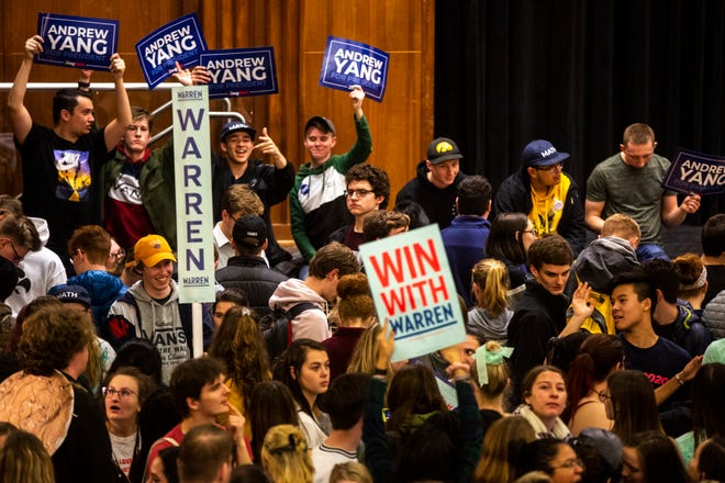 Elizabeth Warren and Andrew Yang supporters rally support while University of Iowa students caucus, Monday, Feb. 3, 2020, at the Iowa Memorial Union in Iowa City, Iowa.