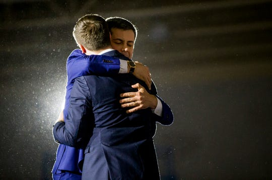 Former South Bend Mayor and democratic presidential hopeful Pete Buttigieg hugs his husband Chasten following his Iowa Caucus Watch Party event inside Drake University on Monday, Feb. 3, 2020, in Des Moines, Iowa.