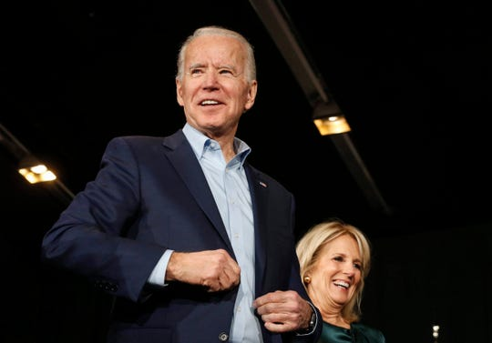Vice President Joe Biden is joined on stage by his wife, Dr. Jill Biden, as he speaks to supporters at the Olmstead Building at Drake University in Des Moines on Monday, Feb. 3, 2020.
