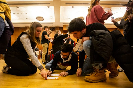 University of Iowa students fill out second preference cards while they caucus, Monday, Feb. 3, 2020, at the Iowa Memorial Union in Iowa City, Iowa.