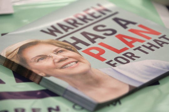 Elizabeth Warren fliers are stacked on a table at the Warren County Indianola VII precinct caucus in the Indianola High School cafeteria.