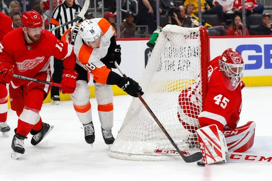 Wings goaltender Jonathan Bernier stops a shot from Flyers center Tyler Pitlick as Filip Hronek defends in the third period Monday.