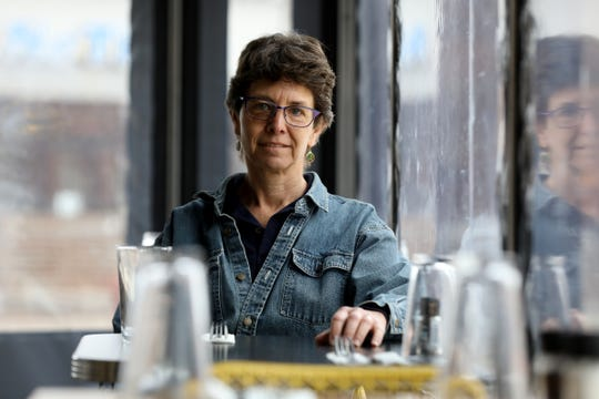 Phillis Engelbert is pictured on Tuesday, Feb. 4, 2020, at Detroit Street Filling Station, one of three restaurants that she owns in Ann Arbor. She routinely hires formerly incarcerated people and those recovering from addiction at her restaurants.