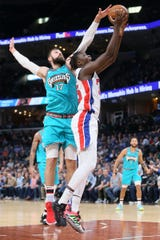 Sekou Doumbouya is defended by Grizzlies' Jonas Valanciunas in the first quarter Monday.