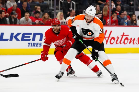 Flyers left wing James van Riemsdyk skates with the puck against Wings left wing Andreas Athanasiou in the first period.