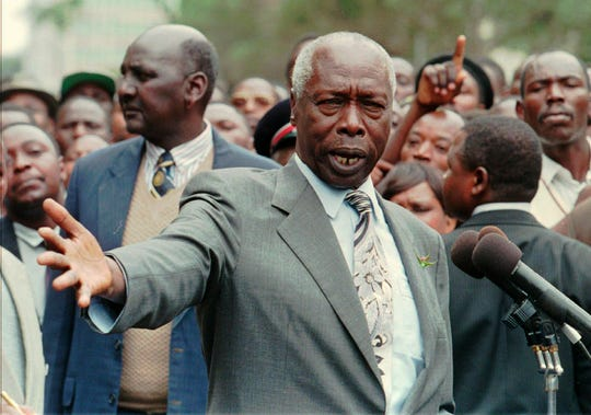 FILE - In this Thursday, July 17, 1997 file photo, President of Kenya Daniel arap Moi talks to bystanders in the street outside the President's Office in Nairobi where he stopped briefly to address people.