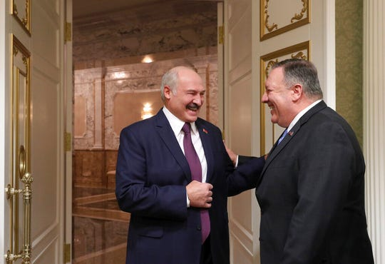 Belarusian President Alexander Lukashenko, left, and U.S. Secretary of State Mike Pompeo smile as they talk to each other during their meeting in Minsk, Belarus, Saturday, Feb. 1, 2020.