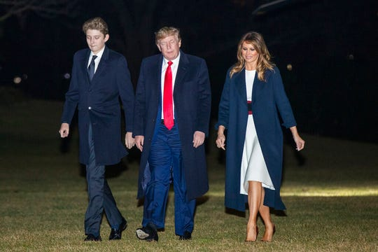 President Donald Trump together with first lady Melania Trump and their son Barron Trump, arrive at the White House, Sunday, Feb. 2, 2020, in Washington from a weekend trip at his Mar-a-Lago estate in Palm Beach, Fla.