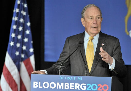 Democratic presidential candidate Mike Bloomberg addresses more than 450 people in a building at Eastern Market.
