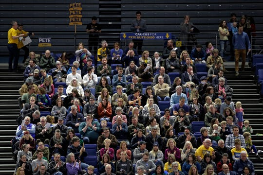 Caucus goers seated in the section for Democratic presidential candidate former South Bend, Ind., Mayor Pete Buttigieg wait to have their first votes counted at the Knapp Center on the Drake University campus in Des Moines, Iowa, Monday, Feb. 3, 2020.