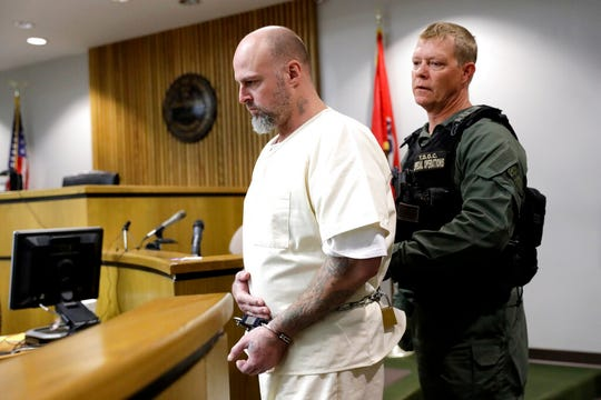 Curtis Watson is escorted into a preliminary hearing Wednesday, Nov. 20, 2019, in Ripley, Tenn. Watson is charged with murdering Tennessee Department of Correction department administrator Debra Johnson after he escaped from the West Tennessee State Penitentiary in August.