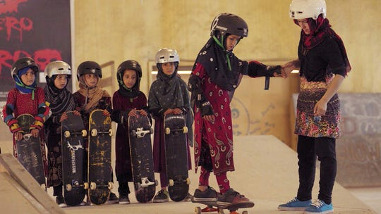 "A scene from ""Learning to Skateboard in a Warzone (If You're a Girl)."""