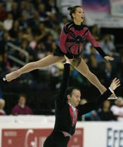 France's Sarah Abitbol and Stephane Bernadis compete in pairs free skate event of the World Figure Skating Championships at the MCI Center in Washington D.C. on March 26, 2003.