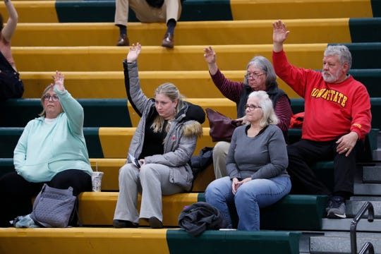 Supporters for Democratic presidential candidate businessman Andrew Yang raise their hands to be counted during a Democratic party caucus at Hoover High School, Monday, Feb. 3, 2020, in Des Moines, Iowa.
