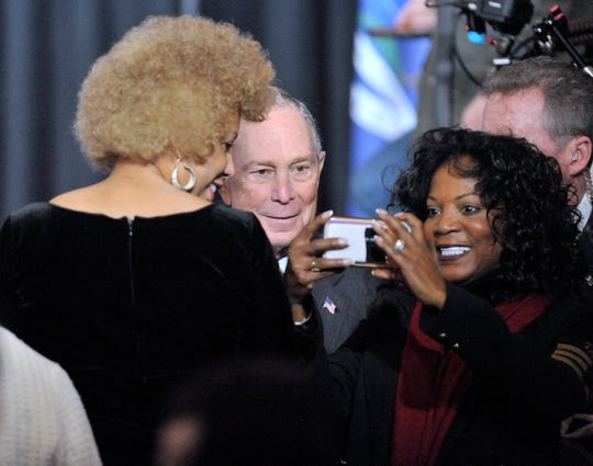 Democratic presidential candidate Mike Bloomberg takes selfies with attendees after he speaks.