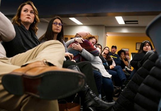 Lisa Householder is embraced after giving an emotional speech during a school diversity and inclusion meeting community meeting at Liberty School in Saline, Mich., Monday, Feb. 3, 2020. The meeting was hosted by Saline Area Schools in response to the racist Snapchat incident that occurred this past week.