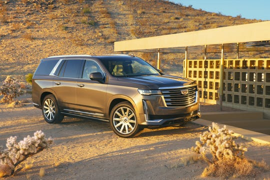 The fifth-generation 2021 Cadillac Escalade dials back the chunky, vertical design cues for a more subtle look that integrates horizontal touches first seen on Cadillac's Escala concept car.