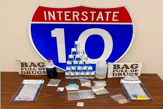In this photo made available by the Florida Highway patrol shows confiscated drugs following the arrest of two men Tuesday, Feb. 4, 2020, Santa Rosa County, Fla. Authorities confiscated methamphetamine, cocaine and fentanyl.