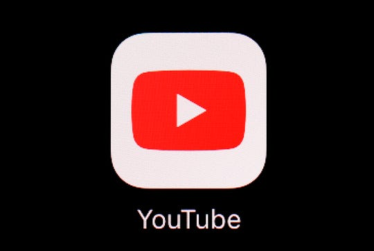 """FILE - This March 20, 2018, file photo shows the YouTube app on an iPad. YouTube is making clear there will be no """"birtherism"""" on its platform during this year's U.S. presidential election."""